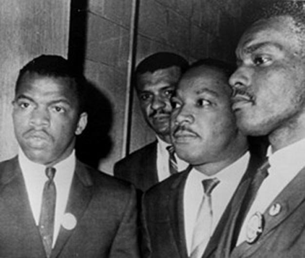 C.T. Vivian (background) with Martin Luther King to his left and John Lewis to his right